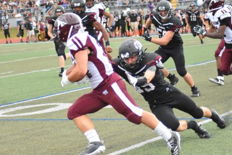 Jay Zheng '22 evades a tackle from a Radnor linebacker. | Photos courtesy of The Enchiridion