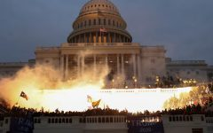 An explosion caused by a police munition is seen while supporters of U.S. President Donald Trump gather in front of the U.S. Capitol Building in Washington, U.S., January 6, 2021. REUTERS/Leah Millis