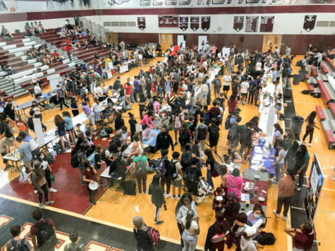 Students peruse activities in the Bryant Gymnasium and lower atrium. Club leaders reported record sign-ups | Photo courtesy of Anika Xi 23