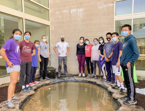 The team celebrates the progress made so far on the koi pond. | Photo courtesy of Amy Huang 23