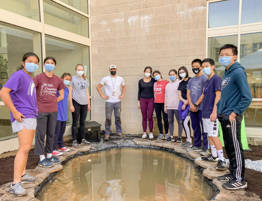 The team celebrates the progress made so far on the koi pond.   Photo courtesy of Amy Huang 23